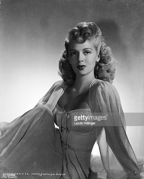Hollywood actress Lana Turner in a dress with bodice top and transparent sleeves