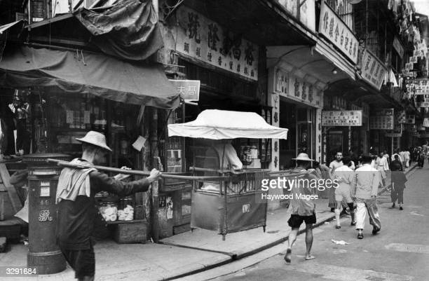 A palanquin or litter passes a British post box in Hong Kong Original Publication Picture Post 4888 Hong Kong The Waiting Days pub 1949