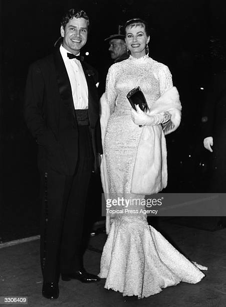 Anthony Steel arrives with his wife Anita Ekberg at the Royal Film Performance of 'The Battle of the River Plate' at the Empire Leicester Square The...