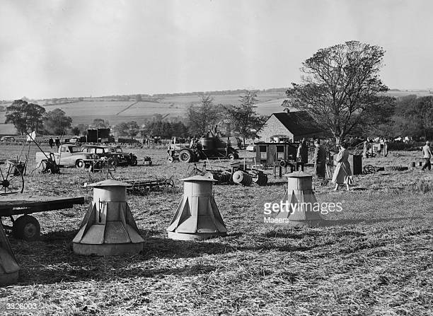 Farming implements and machinery of all kinds spread over a field are for sale at 'Stow Fair' which is held every year at StowontheWold in...