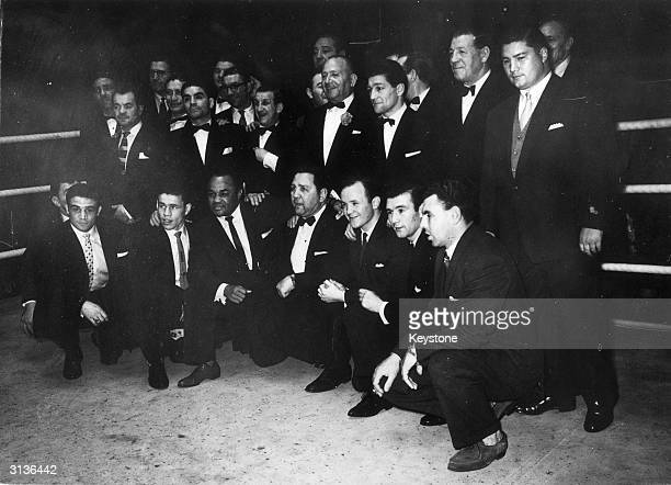 Boxing promotor Jack Solomons and boxing champions at Harringay Arena Back row from left to right Randolph Turpin Dave Crowley Jack Petersen Harry...