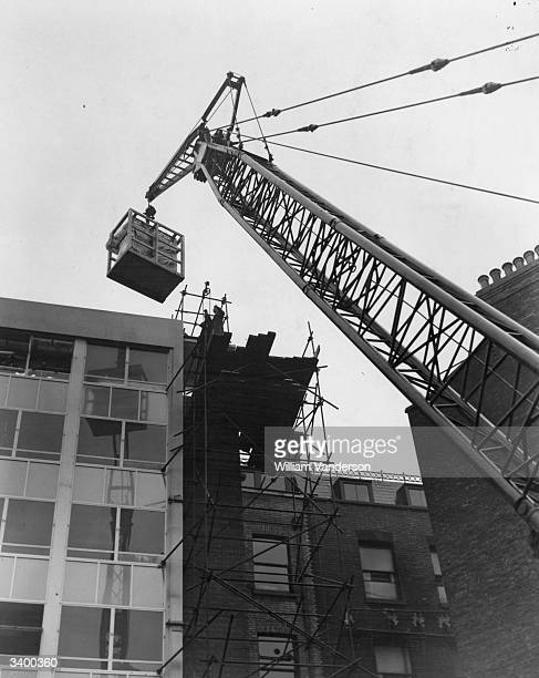 Univac' computer has to be hoisted by crane for installation on the fifth floor of Remington House on Holborn Viaduct, in London.