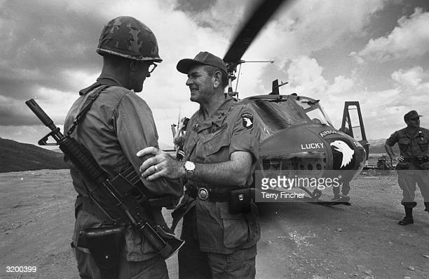 General Melvin Zais commanding General of the 101st United States Airbourne Division greets a fellow American soldier