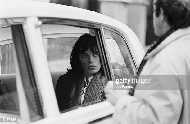 Mick Jagger of the Rolling Stones borrows a Rolls Royce from John Lennon for a scene in the Nicolas Roeg film 'Performance'