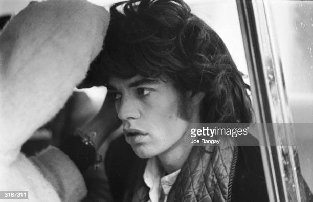 Mick Jagger of the Rolling Stones has his wig adjusted for a scene in the Nicolas Roeg film 'Performance'.