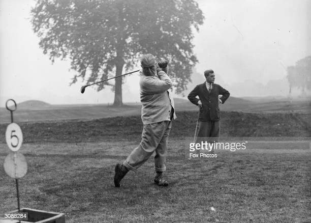 Aga Khan III leader of the Ismaili muslim sect playing golf