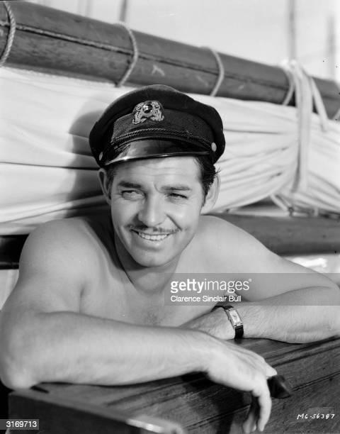 American actor Clark Gable on board a yacht