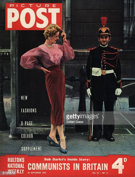 A model wearing Hubert de Givenchy's 'rose theme' outfit of blouse and velvet skirt flirts with a soldier 'enguard' in ceremonial uniform of the...
