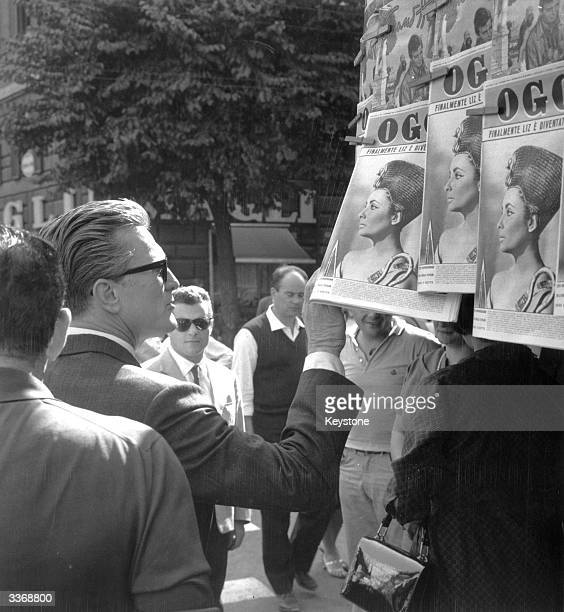 While in Rome for the filming of, 'Two Weeks in Another Town' directed by Vincente Minnelli, the actor Kirk Douglas stops to look at a picture of...