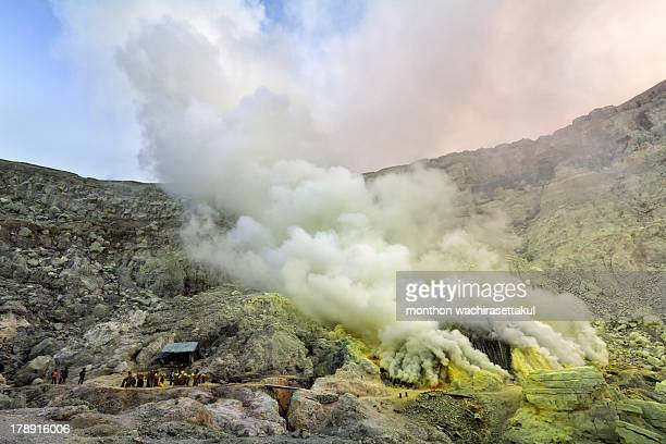 Unidentified miner harvests raw sulphur from the crater of Kawah Ijen volcano in hazardous working environment with minimal protection on 29 July...