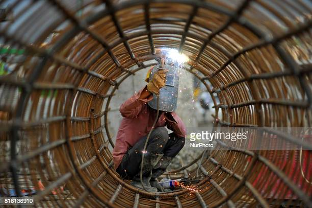 CHAUDHARY 29yrs old migrated from sunsari welding iron pillar for ongoing Bridge expansion work supported by China AID at Kalanki Kathmandu Nepal on...