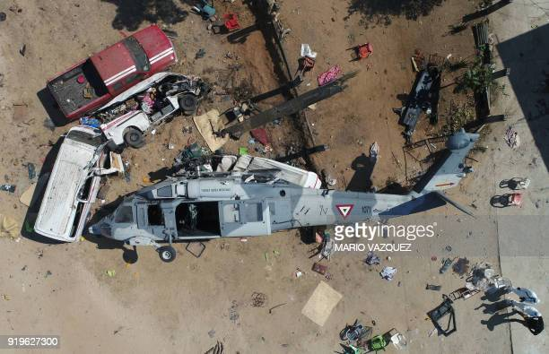 TOPSHOT Aerial view of the military helicopter that fell on a van in Santiago Jamiltepec Oaxaca state Mexico on February 17 2018 A 72magnitude...