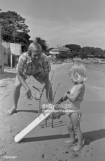 2nd 1976: Tony Greig playing cricket with his daughter Samantha on the beach at Camp Cove, Sydney, 1976.