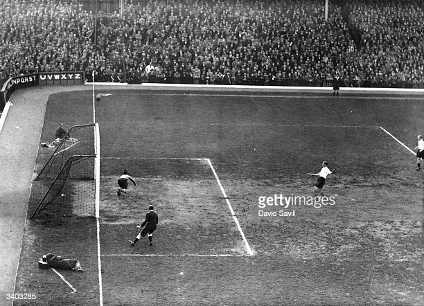 Arsenal goalkeeper Swinden dives to save a Charlton Athletic penalty kick during a match at Highbury London