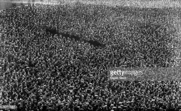 Huge crowds turn out for the Arsenal game against Charlton at Highbury, London.
