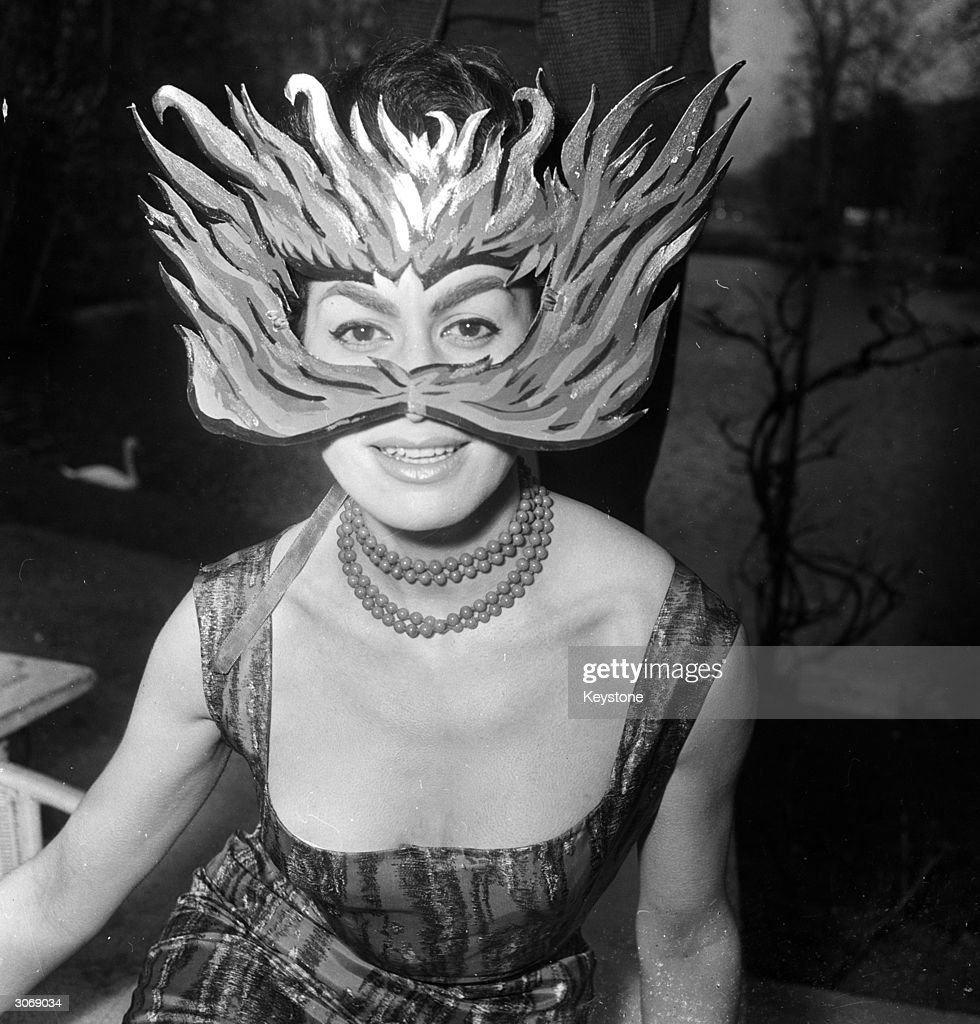 Paris model Luce Bona wears a mask suited to her new role as possessor of 'The World's Most Diabolical Eyes'. She was awarded the title by a jury of crime fiction writers who decided that Luce 'best embodies the heroine of detective stories'.