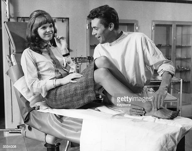 Dirk Bogarde and Samantha Eggar in a scene from the film 'Doctor In Distress'