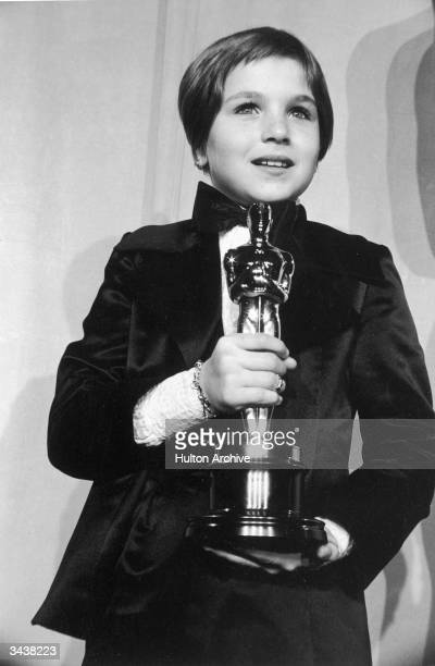 American actor Tatum O'Neal wearing a tuxedo holds her Oscar for Best Supporting Actress for her role in director Peter Bogdanovich's film 'Paper...