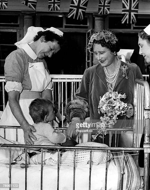 2nd April The Queen Mother meets Robert eleven months old and the youngest child in the hospital during her visit to Chailey Heritage Craft School...