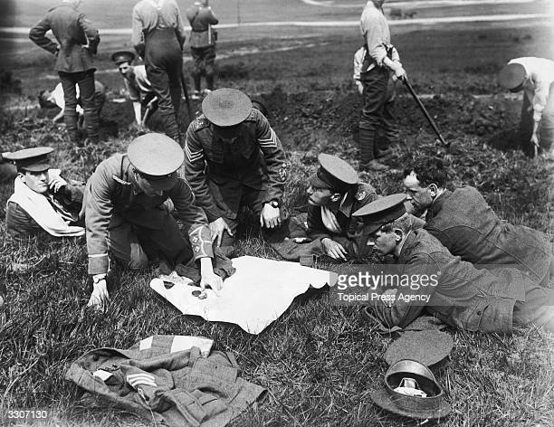 Soldiers of the County of London reading a map at an army training camp in Aldershot