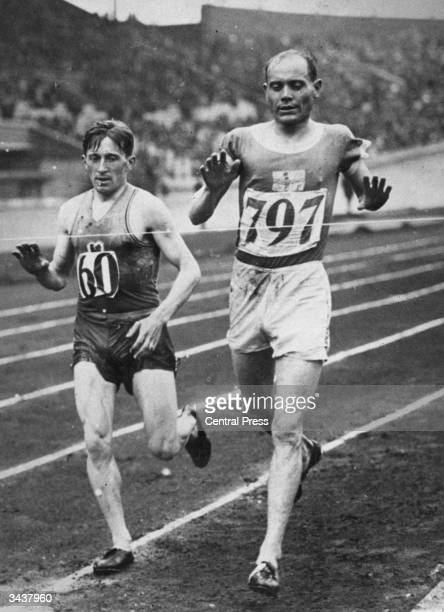 Finnish athlete Paavo Nurmi finishing a heat in the 3000 metres steeplechase at the Amsterdam olympics. He is keeping pace with the French athlete...