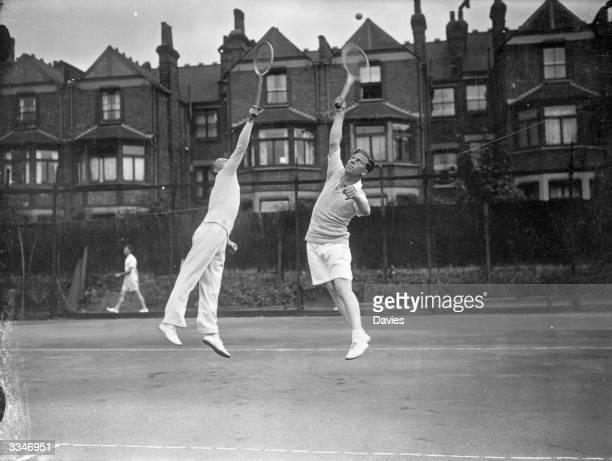 Taylor and Bellamy of Tottenham Hotspur Football Club in action during a tennis match against members of Charlton Athletic FC at a tournament between...