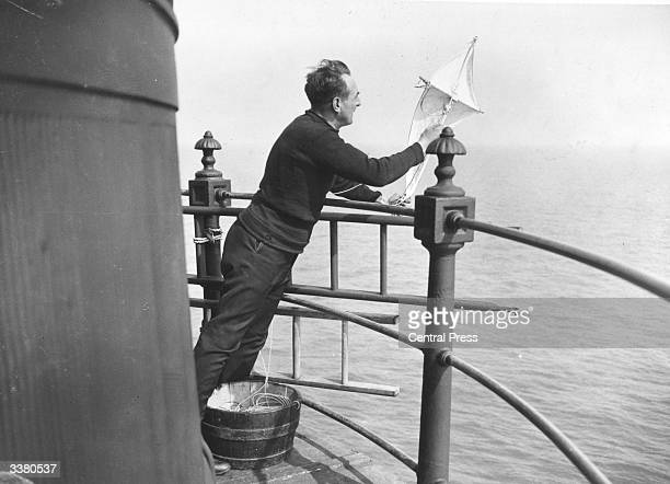 The Wolf Rock lighthouse keeper cannot fish from the lighthouse becasue the base is too rocky, instead the fishing line is attached to a kite which...
