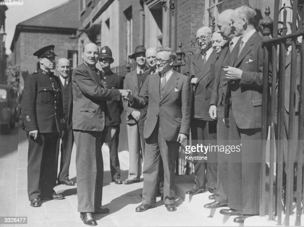 British prime minister Clement Attlee being congratulated by Herbert Morrison on the success of the Potsdam talks Other members of the cabinet...