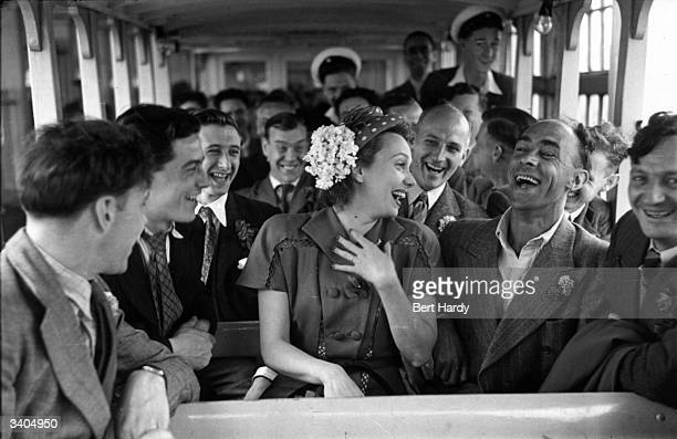 French film actress Mila Parely amuses passengers onboard the ferry from Tower Bridge London to Southend Essex Original Publication Picture Post 4412...