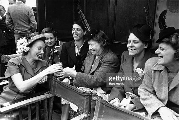 French film actress Mila Parely left meets a group of women from Sunlight Laundry on their annual beano at Southend Essex Original Publication...