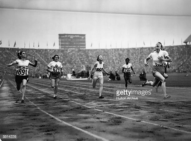 The finish of the women's 100 metres Olympic final at Wembley London won by Fanny BlankersKoen of Holland On the left number 691 is silver medal...