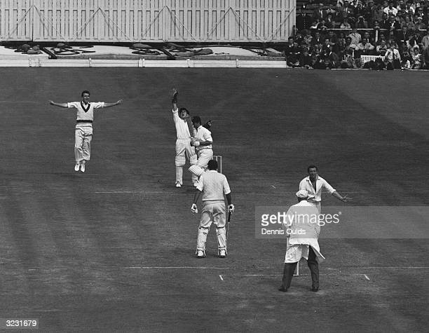 Richie Benaud strikes and England's Ted Dexter is caught for 76 during the last day of the 4th Test at Old Trafford England's second innings ended in...