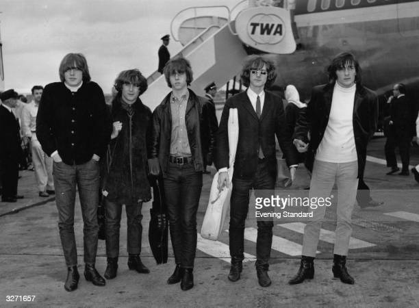 Innovative Californian folkpoprock combo The Byrds at the airport They are Michael Clarke Roger McGuinn Chris Hillman David Crosby and Gene Clark