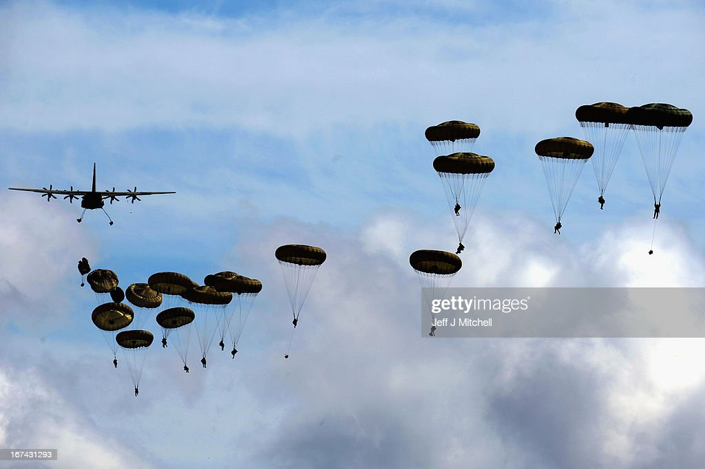 2nd Battalion, Parachute Regiment (2 PARA) parachute from an aeroplane during a British And French Airborne Forces joint exercise on April 25, 2013 in Stranraer, Scotland. Exercise 'Joint Warrior' sees British and French airborne forces demonstrate their readiness to be deployed together as the 'Intermediate Combined Joint Expeditionary Force' ( i-CJEF) on contingency operations, ranging from disaster relief to war fighting.