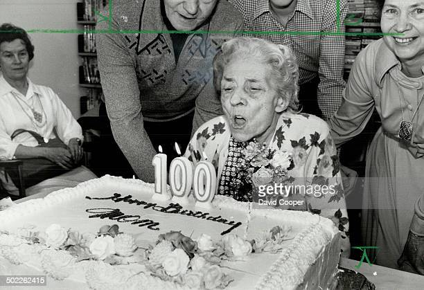 2nd century Emma Louisa Lock 100 years old today blows out candles on her birthday cake at Cummer House home for the aged in North York at a party...