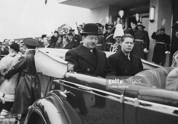 King Carol II and Crown Prince Michael of Romania driving in an open car from the station to the Royal Palace in Bucharest after an extensive tour of...