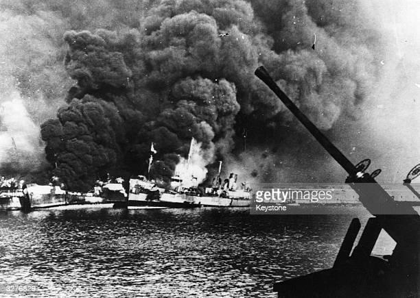 American ships blaze after a Nazi attack on the Adriatic port of Bari, Italy. First reports estimated 1000 casualties and five US vessels lost.