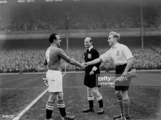 Lauro Amado the captain of the Swiss football team shaking hands with the England captain Billy Wright at Highbury London The referee is Karl Van Der...
