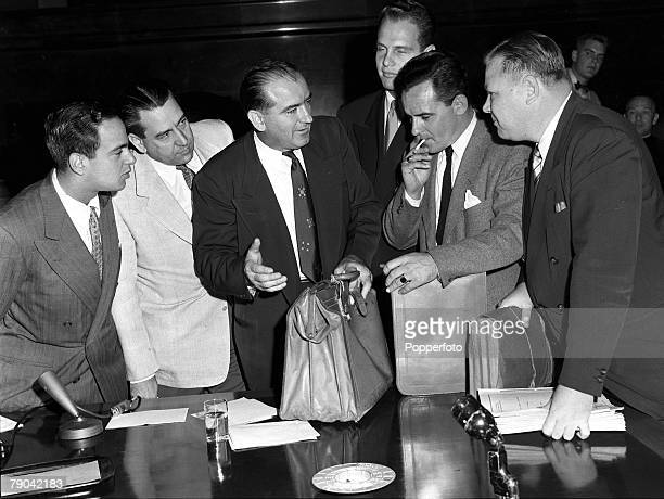 2nd December 1953 Washington USA House of UnAmerican Activities Committee Hearings Senator Joseph McCarthy is pictured with his dispatch case bulging...