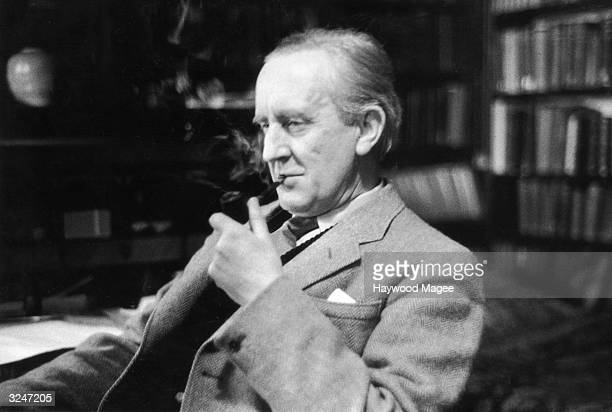British writer J R R Tolkien enjoying a pipe in his study at Merton College Oxford where he is a Fellow Original Publication Picture Post 8464...