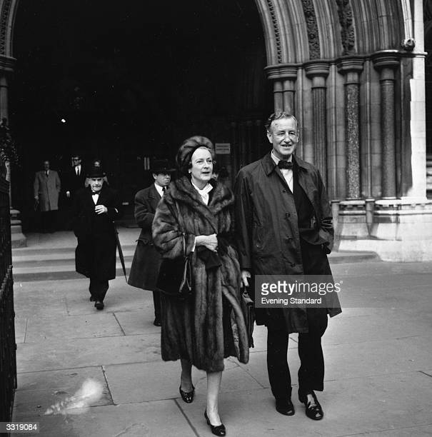 English novelist Ian Fleming creator of secret service agent James Bond leaves court with his wife after a court case