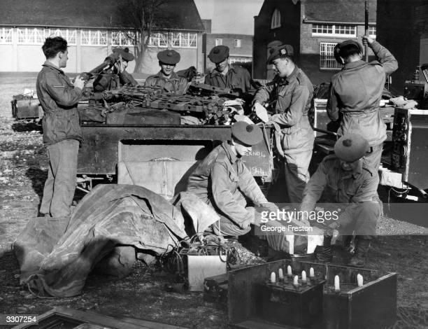 Men of the 1st Battalion of the Royal Scots packing radio equipment at Tidworth Hampshire ready to be airlifted to Zambia in the event of trouble...