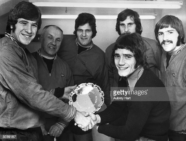 Emlyn Hughes presenting Kevin Keegan with the Evening Standard player of the month award. He is watched by manager Bill Shankly, John Toshack, Ray...