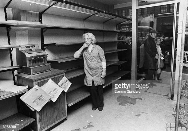 Empty shelves in a bakers shop in Islington with people queuing outside the doorway for the next delivery of bread during the Industrial dispute