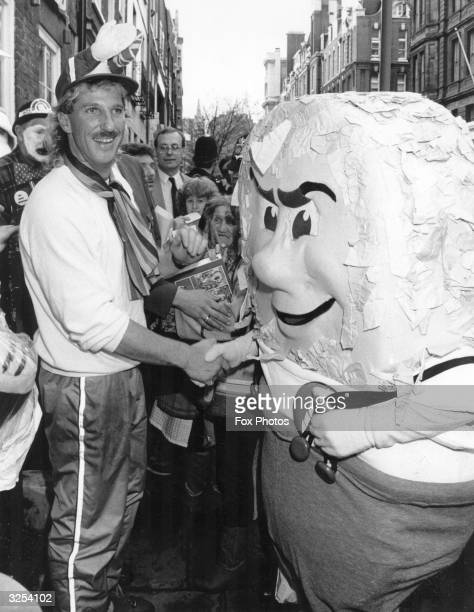 British cricketer Ian Botham and a life size 'Weetabix' character 'Dunk' outside Great Ormond Street Hospital London to raise money for the Leukemia...
