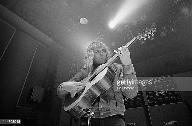 Guitarist Alex Lifeson of Canadian progressive rock band Rush plays an acoustic guitar at a studio in Shepperton Surrey 2nd December 1978
