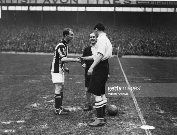 Team captains shake hands before the kick off as West Bromwich Albion play nonleague London Corinthians in the second round of the FA Cup