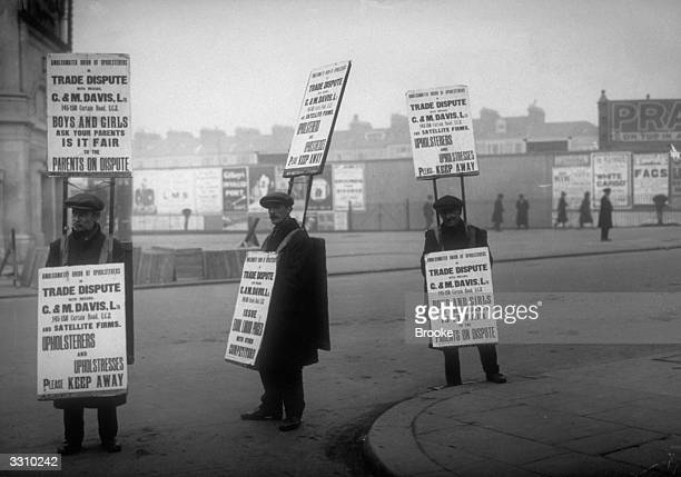 Strikers during a furniture trades dispute parading with sandwich boards