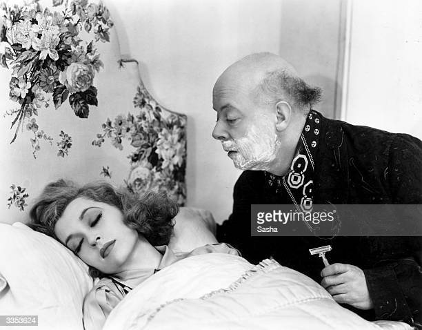 Actress Lilli Palmer asleep in the comedy play, 'Little Ladyship' at the Strand Theatre in London.