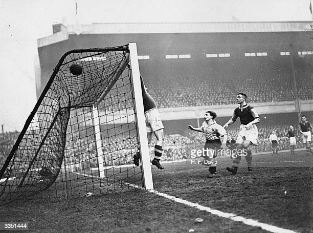 West Ham United goalkeeper Harry Medhurst tips the ball safely over the crossbar from a shot by Tottenham Hotspur's A E Hall during their FA Cup...